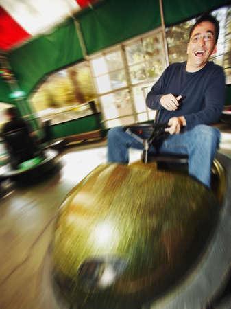 Man at amusement park Stock Photo
