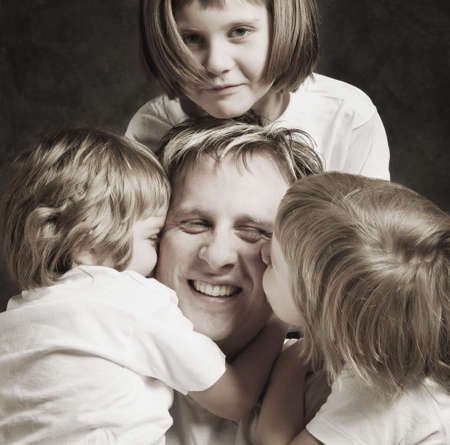 Father with daughters photo