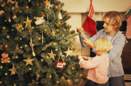Decorating a Christmas tree photo