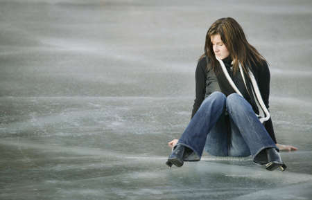 Woman sits on ice Stock Photo