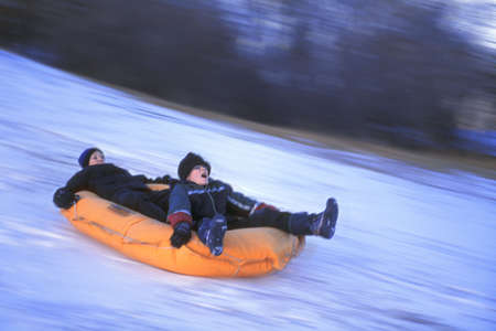 Two children on a raft Stock Photo