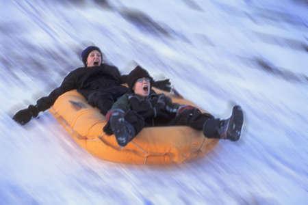 corey hochachka: Two boys on a raft Stock Photo
