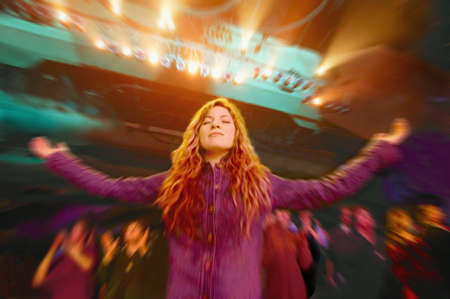 Woman in a worship service Stock Photo - 6214442