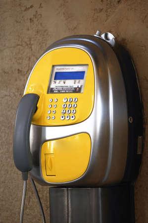黄色の公衆電話 写真素材