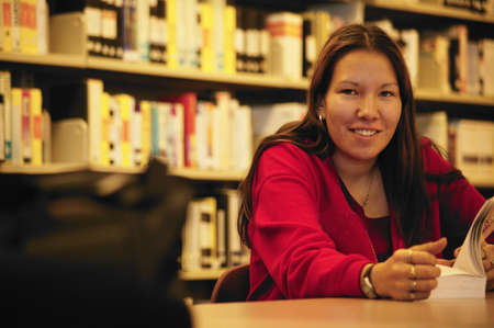 aboriginal woman: Student in the library