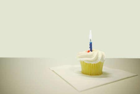 A cupcake with a candle Reklamní fotografie
