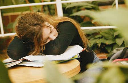 imaginor: Student naps on books Stock Photo