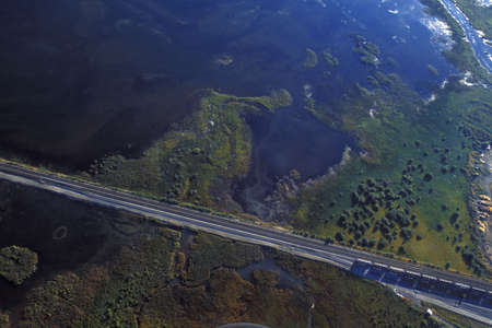 corey hochachka: Aerial view of train tracks and water