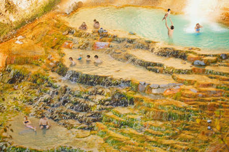 People swimming in a natural hot spring
