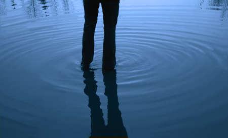 tanasiuk: Walking in water Stock Photo