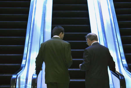 Two men on an escalator