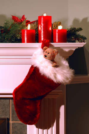 Christmas stocking hanging from fireplace mantle at Christmas Archivio Fotografico