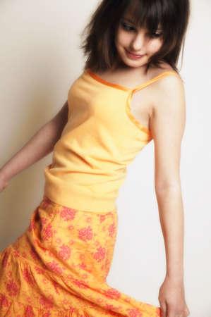 twirls: A girl twirls skirt
