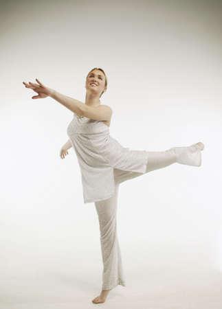 A woman dances Imagens