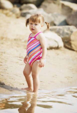 Child on the beach photo