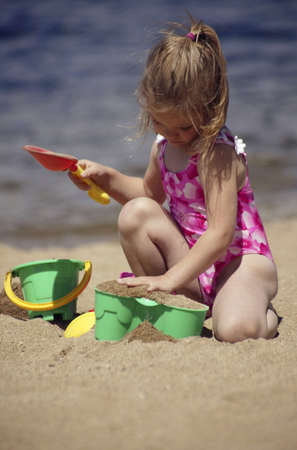 passion play: Child playing in the sand Stock Photo