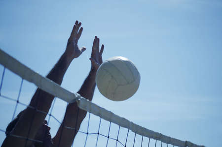A volleyball block Imagens