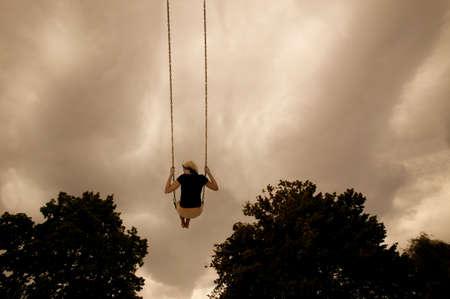 Swinging on a swing Stock Photo