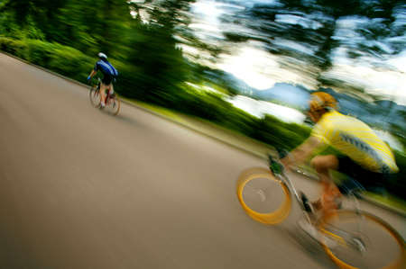 adrenaline rush: Two people on bikes Stock Photo