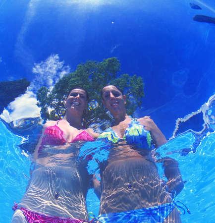 carson ganci: Portrait of two women in bikinis