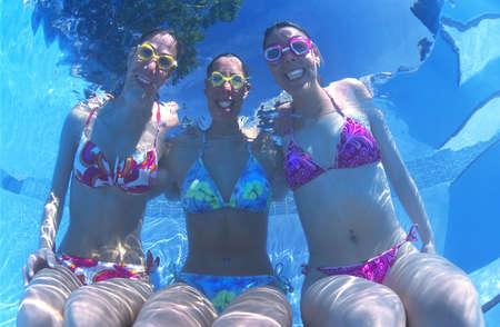 woman in bath: Portrait of Three Women in Bikinis Underwater