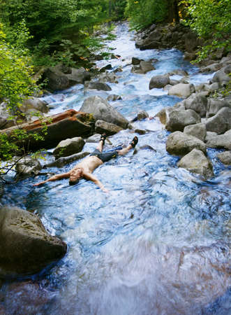 baptize: Laying in a stream