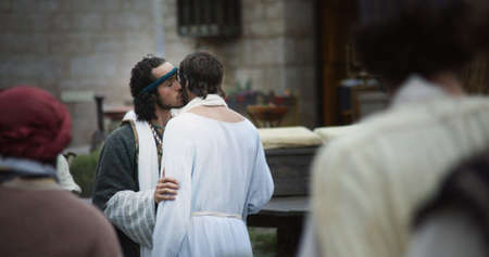 Judas betrays Jesus with a kiss photo