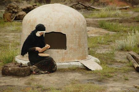 darren greenwood: Woman wearing black bakes bread