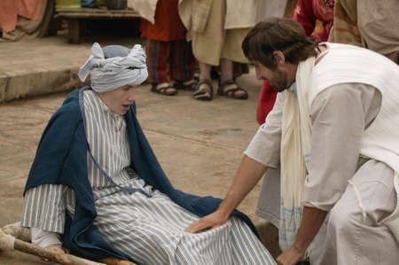 Jesus heals a crippled child Archivio Fotografico