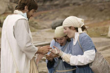 イエスはハンセン病患者を癒す 写真素材