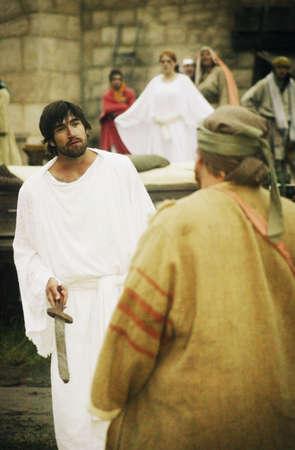 sword act: Jesus talking to disciple