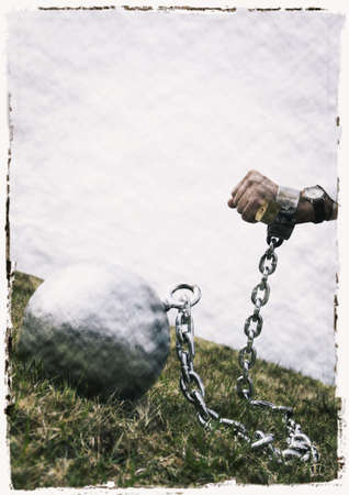 object oppression: A ball and chain Stock Photo