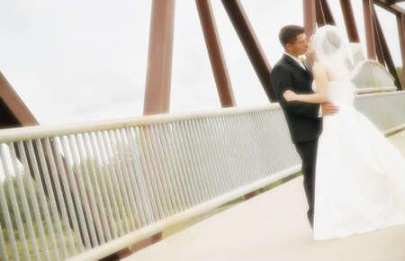 Bride and groom kiss Stock Photo