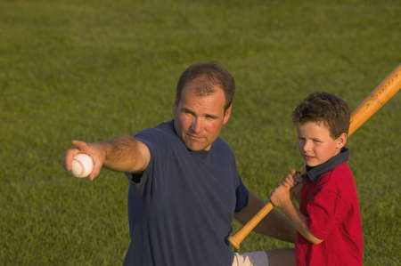 carson ganci: Father and son play baseball Stock Photo