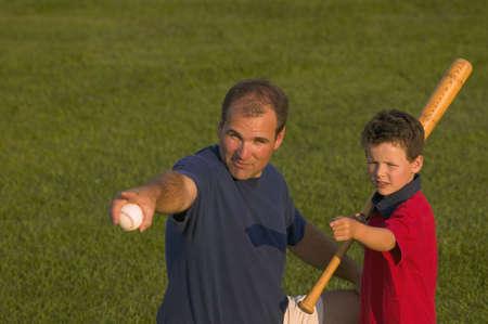 carson ganci: Father and son play baseball Stock Photo