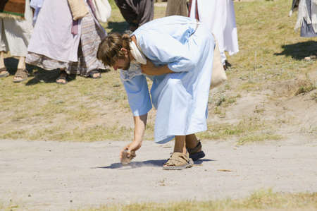 a righteous person: Jesus draws in the sand Stock Photo