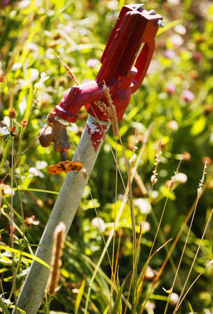 glubish: A water tap in a field