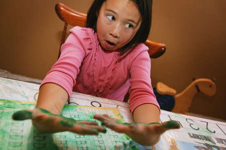 imaginor: child with messy green hands Stock Photo