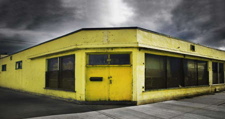 abandoned warehouse: An old yellow building