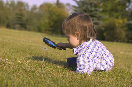 carson ganci: Young boy with magnifying glass Stock Photo