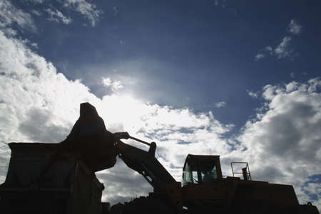 loader: Silhouette of front-end loader Stock Photo