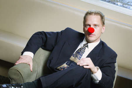 nose: Businessman wearing red nose