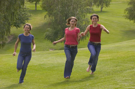 carson ganci: Three teen girls running in park