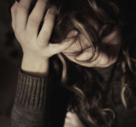 glubish: Woman holding head in hand