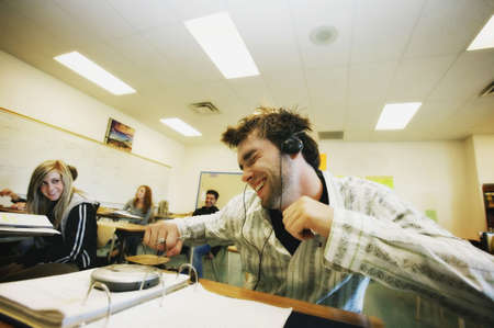 behave: Student listening to music at desk