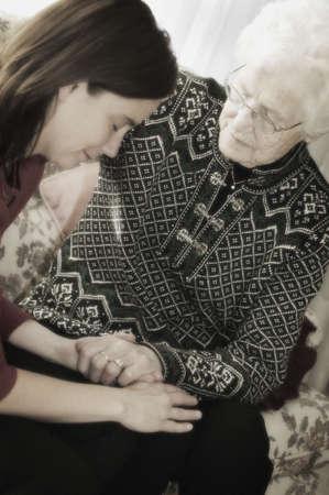 Senior and Woman praying photo
