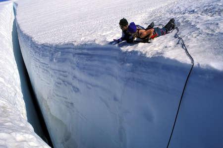 recreational climbing: Looking into a frozen crevice