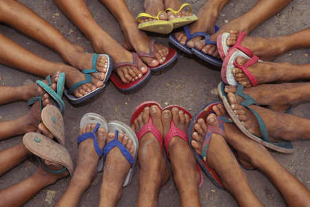 flops: Group of feet in sandals