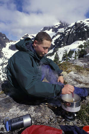 Mountaineer using a camping stove Stock Photo - 5628830