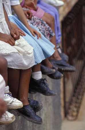 honduras: Row of native children and their shoes